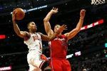 Blake_griffin_tries_to_block_derrick_rose_s_shot_crop_150x100