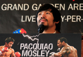NEW YORK, NY - FEBRUARY 14:  Manny Pacquiao addresses the media at a press conference to promote his upcoming fight with Shane Mosley at The Lighthouse at Chelsea Piers on February 14, 2011 in New York City.  (Photo by Chris Trotman/Getty Images)