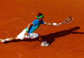 PARIS - JUNE 04:  Rafael Nadal of Spain plays a backhand during the men's singles semi final match between Rafael Nadal of Spain and Jurgen Melzer of Austria at the French Open on day thirteen of the French Open at Roland Garros on June 4, 2010 in Paris, France.  (Photo by Clive Brunskill/Getty Images)