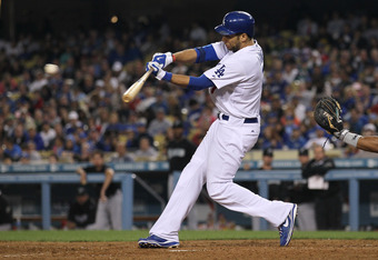 LOS ANGELES - JULY 5: James Loney #7 of the Los Angeles Dodgers hits an RBI double in the eighth inning against the Florida Marlins on July 5, 2010 at Dodger Stadium in Los Angeles, California.  (Photo by Stephen Dunn/Getty Images)