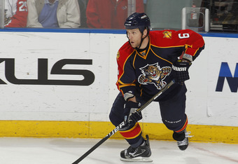 SUNRISE, FL - FEBRUARY 8: Dennis Wideman #6 of the Florida Panthers carries the puck along the boards against the St. Louis Blues on February 8, 2011 at the BankAtlantic Center in Sunrise, Florida. The Blues defeated the Panthers 2-1. (Photo by Joel Auerbach/Getty Images)