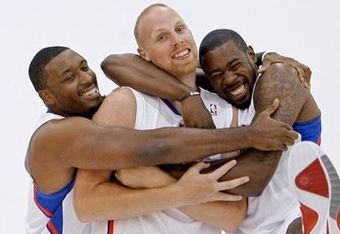 Craig_smith_and_deandre_jordan_wrap_their_arms_around_chris_kaman_crop_340x234