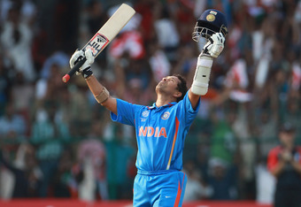 BANGALORE, INDIA - FEBRUARY 27:  Sachin Tendulkar of India celebrates reaching his century during the 2011 ICC World Cup Group B match between India and England at M. Chinnaswamy Stadium on February 27, 2011 in Bangalore, India.  (Photo by Tom Shaw/Getty Images)