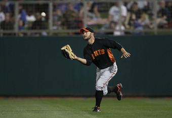 GLENDALE, AZ - MARCH 04:  Outfielder Cody Ross #13 of the San Francisco Giants catches a fly ball out against the Los Angeles Dodgers during the spring training game at Camelback Ranch on March 4, 2011 in Glendale, Arizona.  (Photo by Christian Petersen/Getty Images)