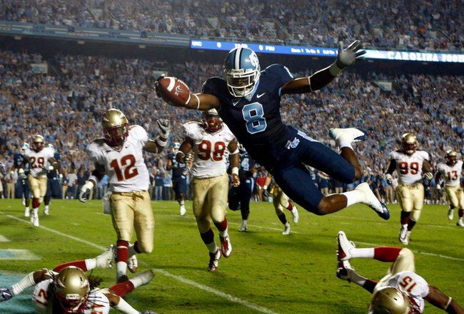 CHAPEL HILL, NC - OCTOBER 22:  Greg Little #8 of the North Carolina Tar Heels dives past Florida State Seminole defenders for a first quarter touchdown at Kenan Stadium on October 22, 2009 in Chapel Hill, North Carolina.  (Photo by Scott Halleran/Getty Images)