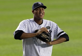 NEW YORK - SEPTEMBER 20:  Ivan Nova #47 of the New York Yankees warms up before playing against the Tampa Bay Rays on September 20, 2010 at Yankee Stadium in the Bronx borough of New York City.  (Photo by Jim McIsaac/Getty Images)