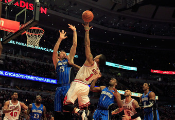 CHICAGO, IL - JANUARY 28: Derrick Rose #1 of the Chicago Bulls puts up a shot between Hedo Turkoglu #15 and Gilbert Arenas #1 of the Orlando Magic at the United Center on January 28, 2011 in Chicago, Illinois. The Bulls defeated the Magic 99-90. NOTE TO USER: User expressly acknowledges and agrees that, by downloading and/or using this photograph, User is consenting to the terms and conditions of the Getty Images License Agreement. (Photo by Jonathan Daniel/Getty Images)