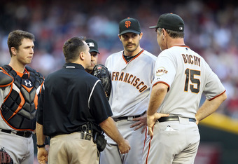 Barry Zito and his mustache talk to Giants manager Bruce Bochy after the San Francisco starter sprained his foot in Saturday's start against the Diamondbacks.