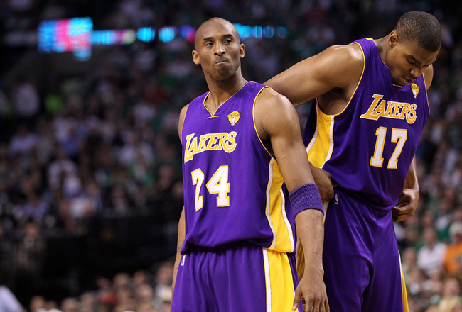 BOSTON - JUNE 13:  (L-R) Kobe Bryant #24 and Andrew Bynum #17 of the Los Angeles Lakers look on against the Boston Celtics during Game Five of the 2010 NBA Finals on June 13, 2010 at TD Garden in Boston, Massachusetts. NOTE TO USER: User expressly acknowledges and agrees that, by downloading and/or using this Photograph, user is consenting to the terms and conditions of the Getty Images License Agreement.  (Photo by Ronald Martinez/Getty Images)