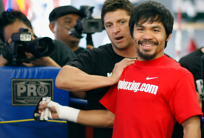 HOLLYWOOD, CA - APRIL 20:  Manny Pacquiao (R) of the Philippines trains with strength coach Alex Ariza (L) during a media workout at the Wild Card Boxing Club on April 20, 2011 in Hollywood, California.  (Photo by Jeff Gross/Getty Images)