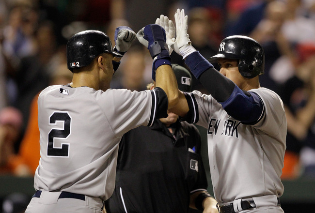 BALTIMORE, MD - APRIL 23: Derek Jeter #2 congratulates Alex Rodriguez #13 of the New York Yankees after Rodriguez hit a grand slam home run against the Baltimore Orioles during the eighth inning at Oriole Park at Camden Yards on April 23, 2011 in Baltimore, Maryland. (Photo by Rob Carr/Getty Images)