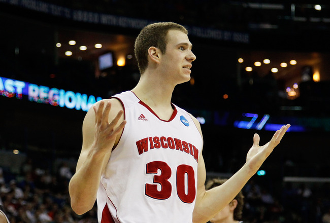 NEW ORLEANS, LA - MARCH 24:  Jon Leuer #30 of the Wisconsin Badgers reacts after being called for a foul against the Butler Bulldogs during the Southeast regional of the 2011 NCAA men's basketball tournament at New Orleans Arena on March 24, 2011 in New Orleans, Louisiana.  (Photo by Kevin C. Cox/Getty Images)