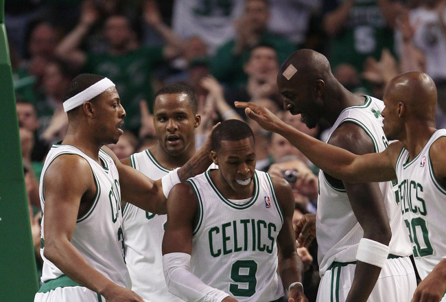 BOSTON, MA - FEBRUARY 06:  Rajon Rondo #9 of the Boston Celtics is congratulated by teammates Paul Pierce #23,Glen Davis #11,Kevin Garnett #5 and Ray Allen #20 after Rondo drew the foul in the second half agianst the Orlando Magic on February 6, 2011 at the TD Garden in Boston, Massachusetts. The Celtics defeated the Magic 91-80. NOTE TO USER: User expressly acknowledges and agrees that, by downloading and/or using this Photograph, User is consenting to the terms and conditions of the Getty Images License Agreement.  (Photo by Elsa/Getty Images)