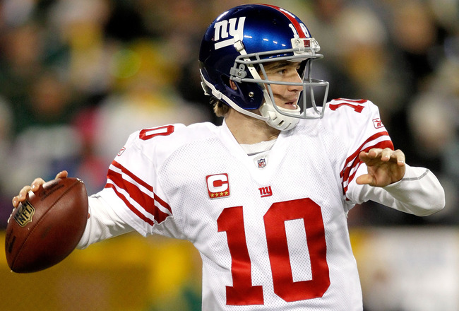 GREEN BAY, WI - DECEMBER 26:  Eli Manning #10 of the New York Giants throws against the Green Bay Packers at Lambeau Field on December 26, 2010 in Green Bay, Wisconsin.  (Photo by Matthew Stockman/Getty Images)