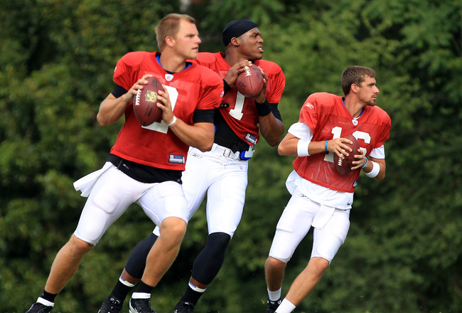 SPARTANBURG, SC - AUGUST 03:  Teammates Jimmy Clausen #2, Cam Newton #1 and Tony Pike #16 of the Carolina Panthers compete in a workout during training camp at Wofford College on August 3, 2011 in Spartanburg, South Carolina.  (Photo by Streeter Lecka/Getty Images)