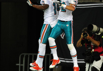 Brian Hartline and Marlon Moore celebrate a Miami Touchdown.