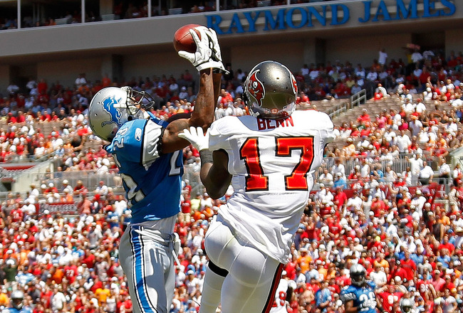 TAMPA, FL - SEPTEMBER 11:  Chris Houston #23 of the Detroit Lions makes an interception against  Arrelious Benn #17 of the Tampa Bay Buccaneers during the season opener at Raymond James Stadium on September 11, 2011 in Tampa, Florida.  (Photo by Mike Ehrmann/Getty Images)