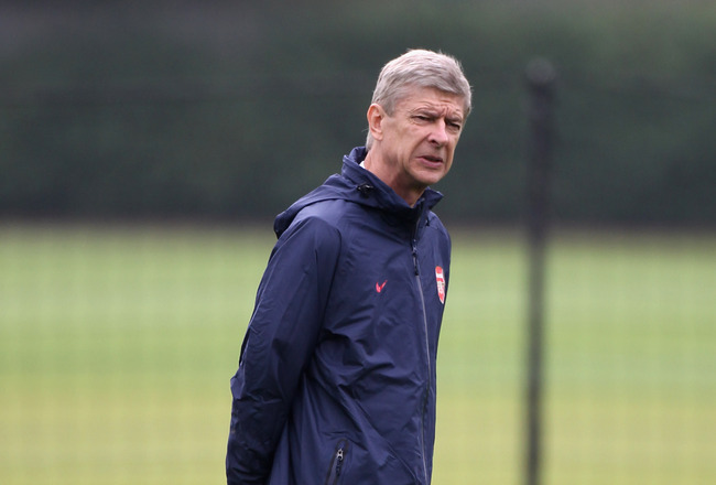 ST ALBANS, ENGLAND - SEPTEMBER 27:  Arsene Wenger of Arsenal looks on during a training session ahead of their UEFA Champions League Group match against Olympiacos at London Colney on September 27, 2011 in St Albans, England.  (Photo by Clive Rose/Getty Images)
