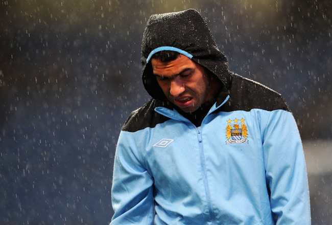 MANCHESTER, ENGLAND - SEPTEMBER 21: Carlos Tevez of Manchester City warms up in the rain before the Carling Cup Third Round match between Manchester City and Birmingham City at the Etihad Stadium on September 21, 2011 in Manchester, England.  (Photo by Michael Regan/Getty Images)