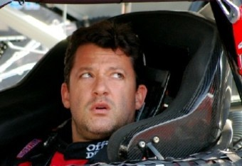National Association  Stock  Auto Racing Tony Stewart on Tony Stewart Gets Ready To Practice And Checks With A Crew Member