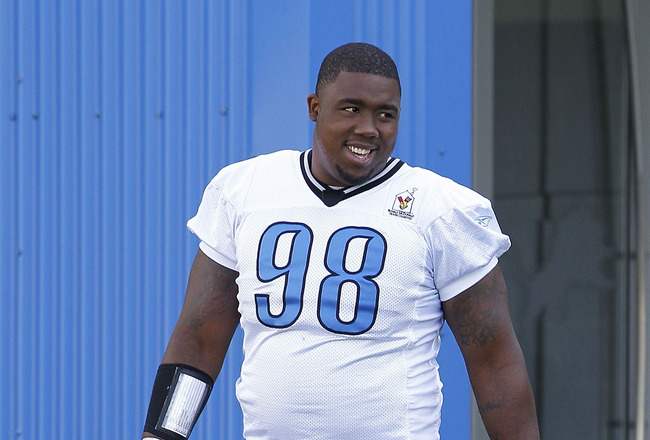 ALLEN PARK, MI - JULY 30:  Nick Fairley #98 of the Detroit Lions walk onto the practice field during training camp at the Lions facility on July 30, 2011 in Allen Park, Michigan.  (Photo by Leon Halip/Getty Images)