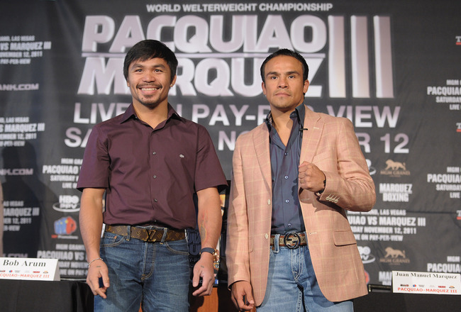 NEW YORK, NY - SEPTEMBER 06:  Professional Boxers Manny  Pacquiao (L) and Juan Manuel Marquez attend the press conference for  their World Welterweight Championship Fight at The Lighthouse at Chelsea  Piers on September 6, 2011 in New York City.  (Photo by Michael  Loccisano/Getty Images)