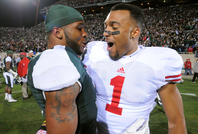 EAST LANSING, MI - OCTOBER 22:  B.J. Cunningham #3 of the Michigan State Spartans and Nick Toon #1 of the Wisconsin Badgers talk together on the field after the game at Spartan Stadium on October 22, 2011 in East Lansing, Michigan. The Spartans defeated the Badgers 37-31 on the final play of the game.  (Photo by Mark Cunningham/Getty Images)