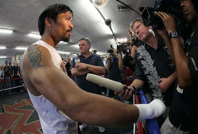HOLLYWOOD, CA - OCTOBER 26:  Manny Pacquia gives  interviews during a Media Workout promoting his upcoming fight with Juan  Manuel Marquez at Wild Card Boxing Club on October 26, 2011 in  Hollywood, California.  (Photo by Stephen Dunn/Getty Images)