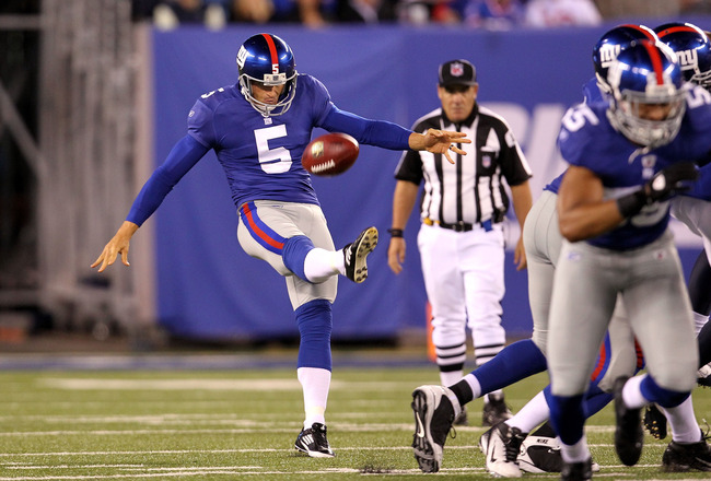EAST RUTHERFORD, NJ - SEPTEMBER 19:  Punter Steve Weatherford #5 of the New York Giants punt against the St. Louis Rams at MetLife Stadium on September 19, 2011 in East Rutherford, New Jersey. The Giants won 28-16. (Photo by Al Bello/Getty Images)