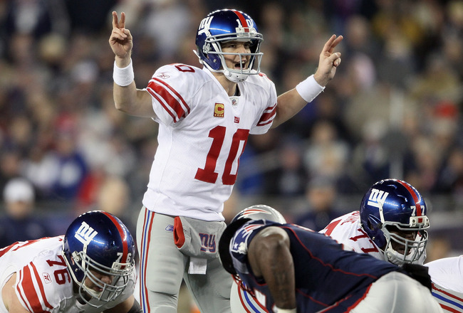 FOXBORO, MA - NOVEMBER 06:  Eli Manning #10 of the New York Giants calls out the play in the fourth quarter against the New England Patriots on November 6, 2011 at Gillette Stadium in Foxboro, Massachusetts. The New York Giants defeated the New England Patriots 24-20.  (Photo by Elsa/Getty Images)