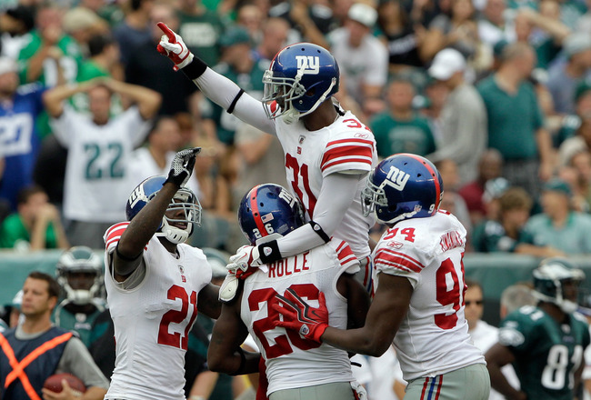 PHILADELPHIA, PA - SEPTEMBER 25: Defensive back  Aaron Ross #31 of the New York Giants celebrates with teammates  Antrel Rolle #26, Kenny Phillips #21 and  Mathias Kiwanuka #93 after Ross intercepted a Philadelphia Eagles pass in the fourth quarter at Lincoln Financial Field on September 25, 2011 in Philadelphia, Pennsylvania.  The Giants defeated the Eagles 29-16. (Photo by Rob Carr/Getty Images)