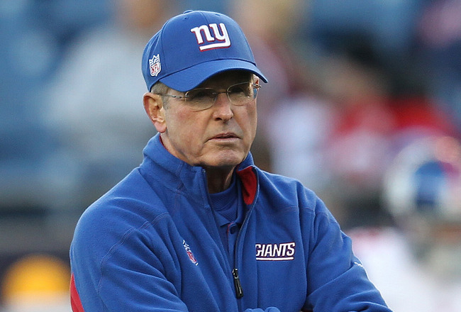 FOXBORO, MA - NOVEMBER 6:   Tom Coughlin of the New York Giants watches drills  before a game with New England Patriots at Gillette Stadium on November 6, 2011 in Foxboro, Massachusetts. (Photo by Jim Rogash/Getty Images)
