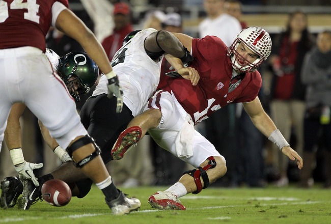 STANFORD, CA - NOVEMBER 12:  Andrew Luck #12 of the Stanford Cardinal fumbles the ball after being sacked by Terrell Turner #45 of the Oregon Ducks at Stanford Stadium on November 12, 2011 in Stanford, California.  (Photo by Ezra Shaw/Getty Images)