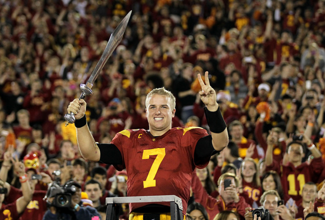 LOS ANGELES, CA - NOVEMBER 26:  Quarterback Matt Barkley #7 of the USC Trojans conducts the band after the game with the UCLA Bruins at the Los Angeles Memorial Coliseum on November 26, 2011 in Los Angeles, California. USC won 50-0.  (Photo by Stephen Dunn/Getty Images)