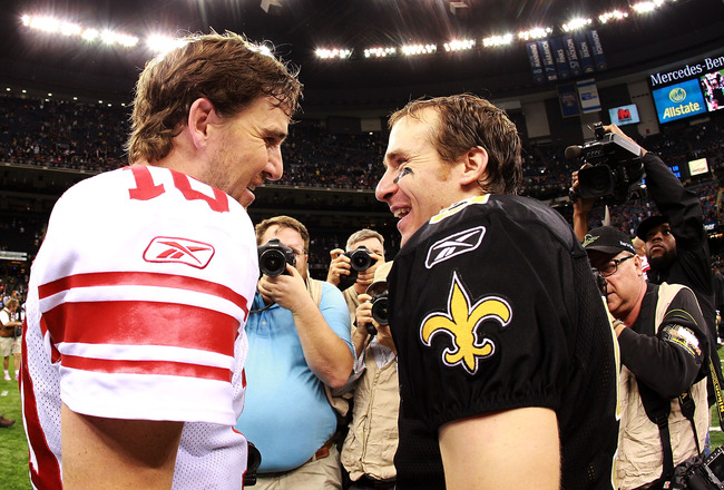 NEW ORLEANS, LA - NOVEMBER 28:  (L-R)  Eli Manning #10 of the New York Giants talks with Drew Brees #9 of the New Orleans Saints after a game at Mercedes-Benz Superdome on November 28, 2011 in New Orleans, Louisiana.  (Photo by Ronald Martinez/Getty Images)
