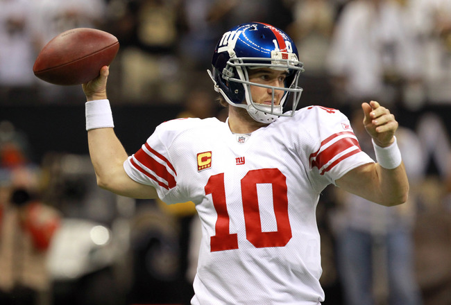 NEW ORLEANS, LA - NOVEMBER 28:  Quarterback Eli Manning #10 of the New York Giants passes the ball against the New Orleans Saints in the second quarter at Mercedes-Benz Superdome on November 28, 2011 in New Orleans, Louisiana.  (Photo by Ronald Martinez/Getty Images)