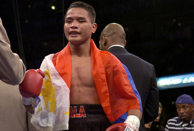 Undefeated Rey Bautista (20 - 0) defeats Giovanni Andrade (52 - 9) in a four-round TKO at the St. Pete Times Forum Dec. 2, 2006 in Tampa. (Photo by A. Messerschmidt/Getty Images) *** Local Caption ***