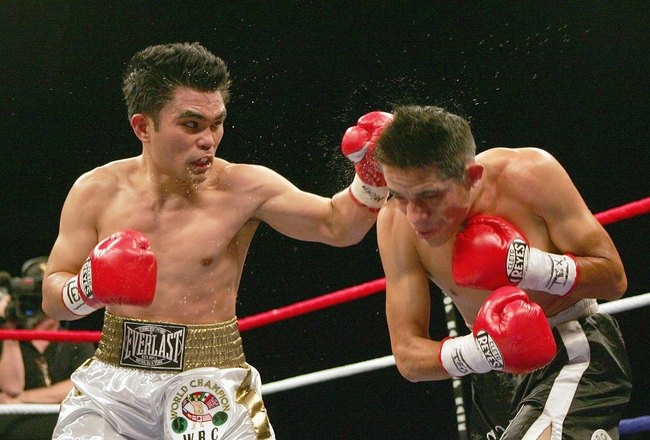 SAN ANTONIO - APRIL 14: Brian Viloria of the USA lands a left punch to Edgar Sosa of Mexico during their WBC Mini Flyweight Championship on April 14, 2007 at the Alamodome in San Antonio, Texas. (Photo by Jed Jacobsohn/Getty Images)