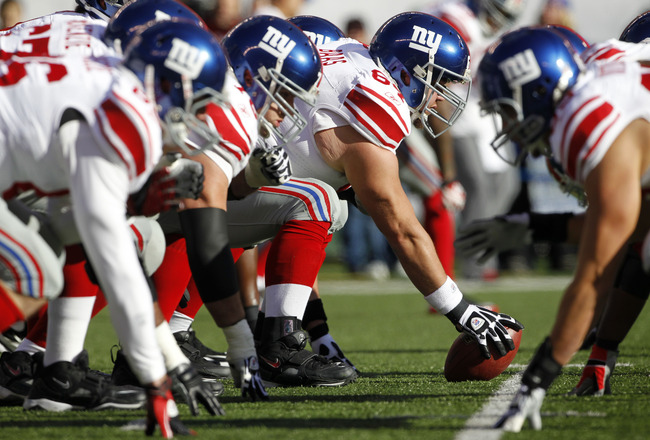 EAST RUTHERFORD, NJ - DECEMBER 24:  David Baas #64 of the New York Giants snaps the ball prior to their game against the New York Jets at MetLife Stadium on December 24, 2011 in East Rutherford. New Jersey. (Photo by Rich Schultz /Getty Images)