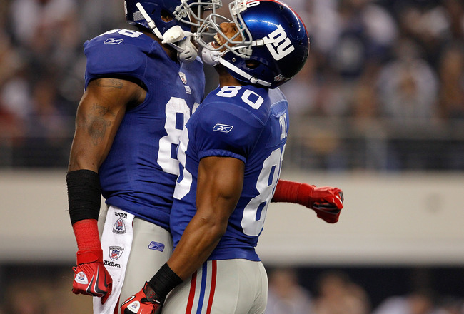 ARLINGTON, TX - DECEMBER 11:   Hakeem Nicks #88 of the New York Giants celebrates with  Victor Cruz #80 of the New York Giants while taking on the Dallas Cowboys at Cowboys Stadium on December 11, 2011 in Arlington, Texas.  (Photo by Tom Pennington/Getty Images)