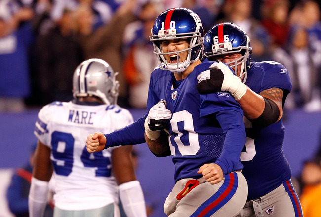 EAST RUTHERFORD, NJ - JANUARY 01:  Eli Manning #10 and  David Diehl #66 of the New York Giants celebrate after a passing touchdown in the fourth quarter at MetLife Stadium on January 1, 2012 in East Rutherford, New Jersey.  (Photo by Jeff Zelevansky/Getty Images)