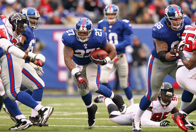 EAST RUTHERFORD, NJ - JANUARY 08:  Brandon Jacobs #27 of the New York Giants runs the ball against the Atlanta Falcons during their NFC Wild Card Playoff game at MetLife Stadium on January 8, 2012 in East Rutherford, New Jersey.  (Photo by Al Bello/Getty Images)