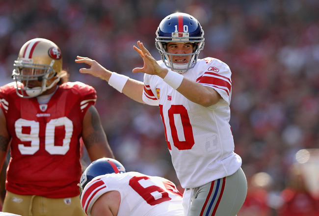 SAN FRANCISCO, CA - NOVEMBER 13:  Eli Manning #10 of the New York Giants in action against the San Francisco 49ers at Candlestick Park on November 13, 2011 in San Francisco, California.  (Photo by Ezra Shaw/Getty Images)