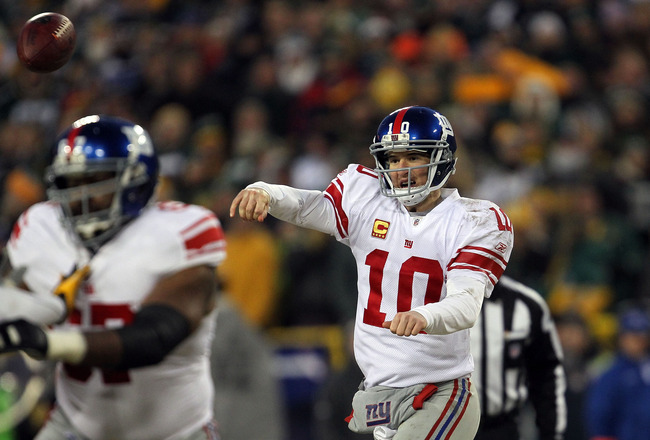 GREEN BAY, WI - JANUARY 15:  Eli Manning #10 of the New York Giants passes against the Green Bay Packers during their NFC Divisional playoff game at Lambeau Field on January 15, 2012 in Green Bay, Wisconsin.  (Photo by Jonathan Daniel/Getty Images)