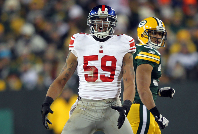 GREEN BAY, WI - JANUARY 15:  Michael Boley #59 of the New York Giants reacts after a sack in the fourth quarter against the Green Bay Packers during their NFC Divisional playoff game at Lambeau Field on January 15, 2012 in Green Bay, Wisconsin.  (Photo by Jamie Squire/Getty Images)