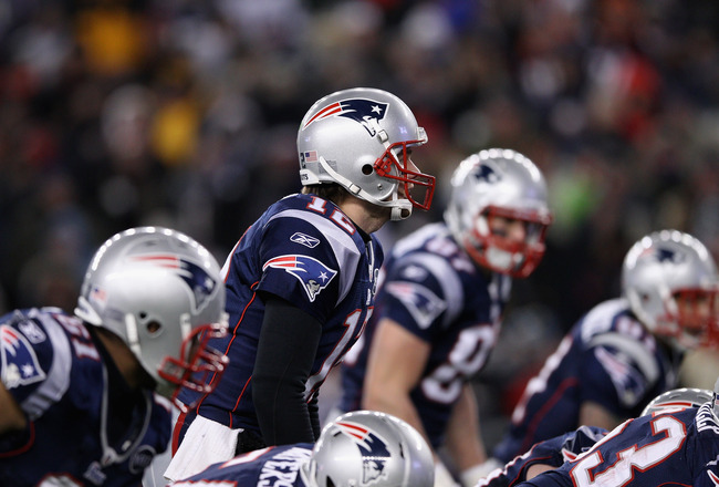 FOXBORO, MA - JANUARY 14:  Tom Brady #12 of the New England Patriots calls signals out at the line of scrimmage against the Denver Broncos during their AFC Divisional Playoff Game at Gillette Stadium on January 14, 2012 in Foxboro, Massachusetts.  (Photo by Elsa/Getty Images)