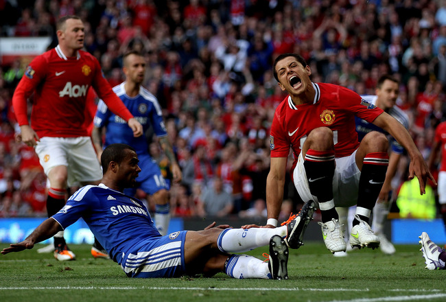 MANCHESTER, ENGLAND - SEPTEMBER 18:  Javier Hernandez of Manchester United is tackled by Ashley Cole of Chelsea during the Barclays Premier League match between Manchester United and Chelsea at Old Trafford on September 18, 2011 in Manchester, England.  (Photo by Clive Brunskill/Getty Images)