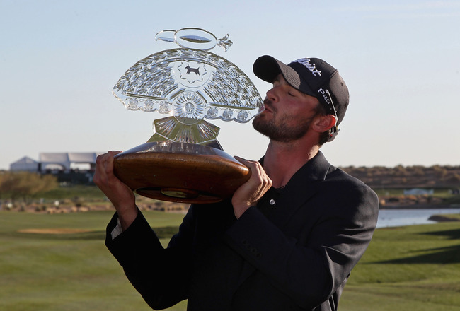 SCOTTSDALE, AZ - FEBRUARY 05:  Kyle Stanley kisses the trophy after winning the Waste Management Phoenix Open at TPC Scottsdale on February 5, 2012 in Scottsdale, Arizona.  (Photo by Christian Petersen/Getty Images)