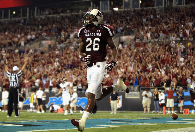 CHARLOTTE, NC - SEPTEMBER 03:  Antonio Allen #26 of the South Carolina Gamecocks celebrates after a touchdown against the East Carolina Pirates during their game at Bank of America Stadium on September 3, 2011 in Charlotte, North Carolina.  (Photo by Streeter Lecka/Getty Images)