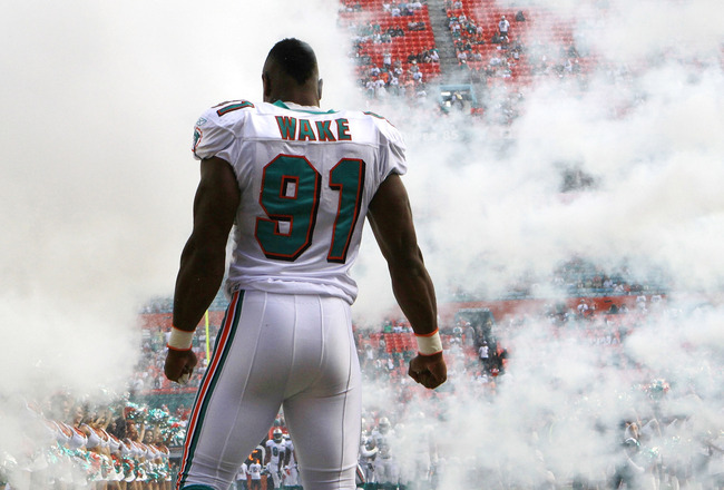 MIAMI GARDENS, FL - DECEMBER 04:  Linebacker Cameron Wake #91 of the Miami Dolphins is introduced against the Oakland Raiders at Sun Life Stadium on December 4, 2011 in Miami Gardens, Florida.  (Photo by Marc Serota/Getty Images)